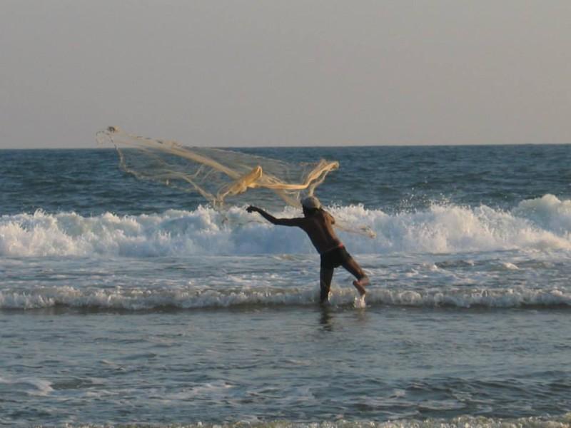Rybář u moře